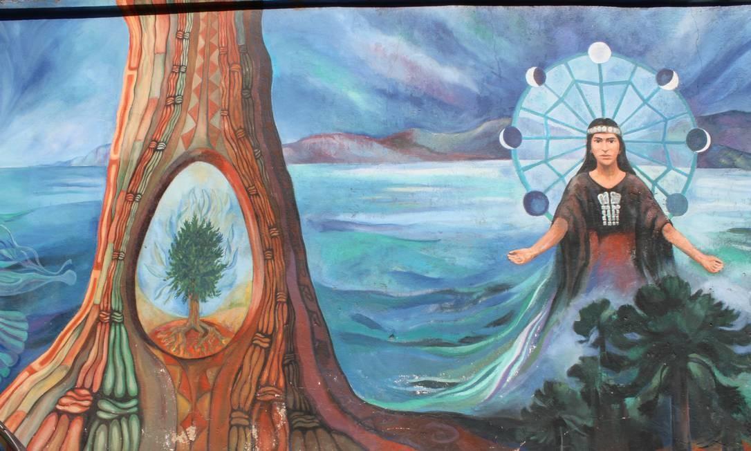 Índio, árvore e mar. A natureza representada em um dos grafites Foto: Ana Beatriz Marin / Agência O Globo