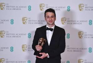 Justin Hurwitz recebe o Bafta de melhor trilha sonora, por 'La la land' Foto: BEN STANSALL / AFP