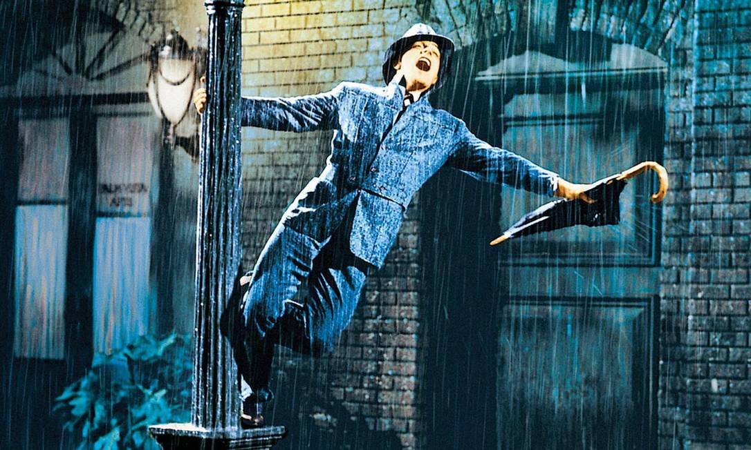 Gene Kelly em cena do filme 'Cantando na chuva' Foto: Reprodução