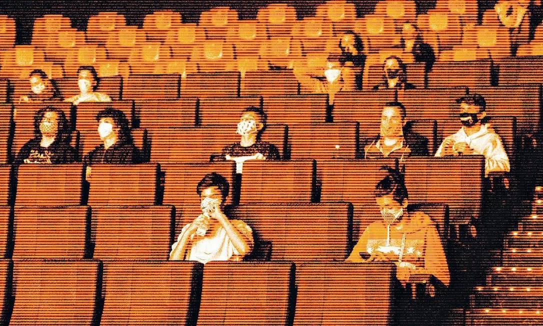 Distanciamento e máscaras, num cinema de Praga, na República Tcheca: novos hábitos Foto: Michal Cizek / AFP