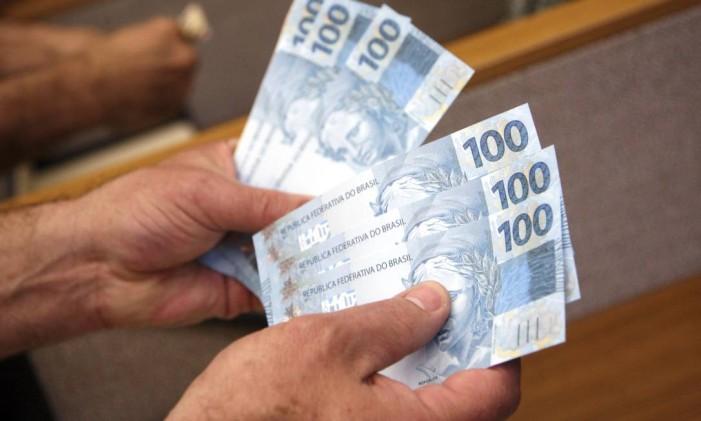 Quanto mais tempo se passa sem pagar as dívidas bancárias, mais difícil fica de quitá-las. Foto: Bloomberg News