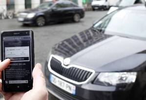 Aplicativo Uber: suspenso em São Paulo Foto: Eliot Blondet / AFP