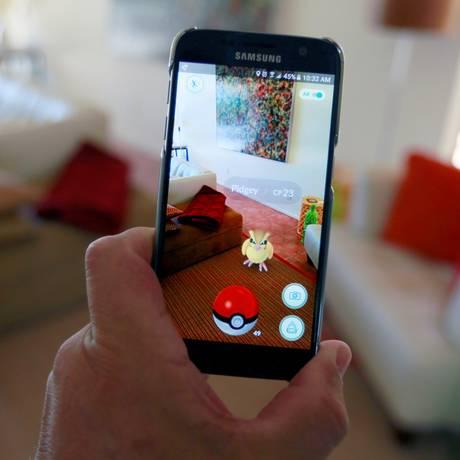 O jogo Pokémon Go, a febre do momento Foto: Sam Mircovich / Reuters