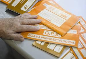 Guias de recolhimento do INSS Foto: Márcia Foletto / Agência O Globo