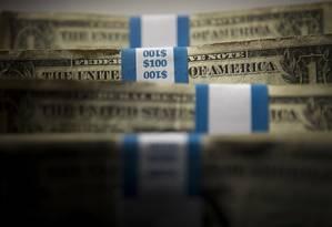 Pacotes com notas de US$ 1 Foto: Scott Eells / Bloomberg