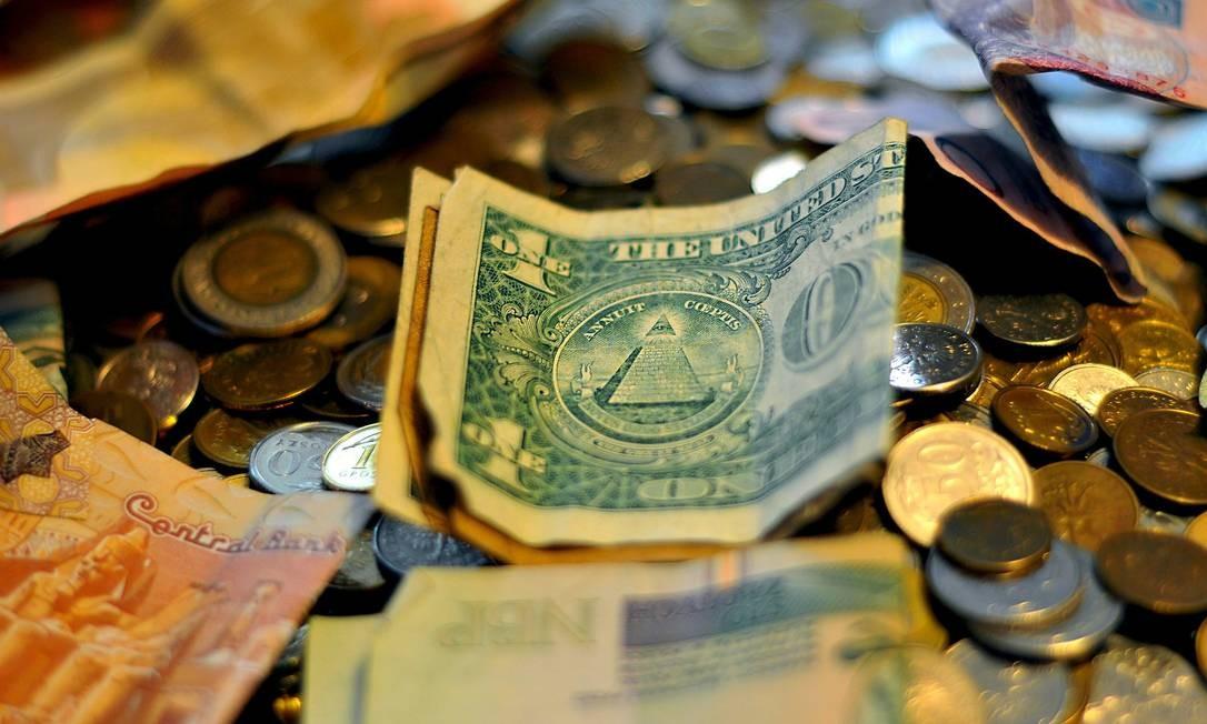 Moedas e notas de dólar Foto: Pixabay