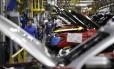 Trabalhadores na fábrica de caminhões da Ford, em Kentucky, EUA. Foto: Luke Sharrett / Bloomberg