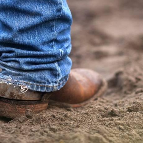 Clássico americano: Blue jeans, botas e esporas. Foto: Ty Wright / Bloomberg