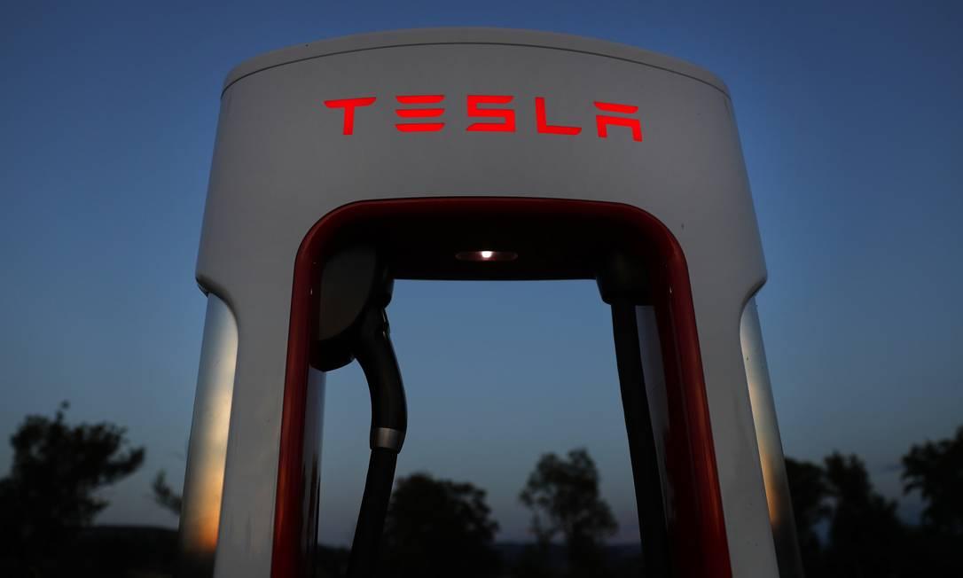 Ações da montadora de carros elétricos caíram cerca de 3,1% nas negociações que acontecem após o fechamento dos mercados e do anúncio do balanço Foto: Stefan Wermuth / Bloomberg