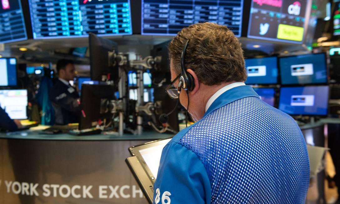 Corretores na Bolsa de Nova York Foto: BRYAN R. SMITH / AFP