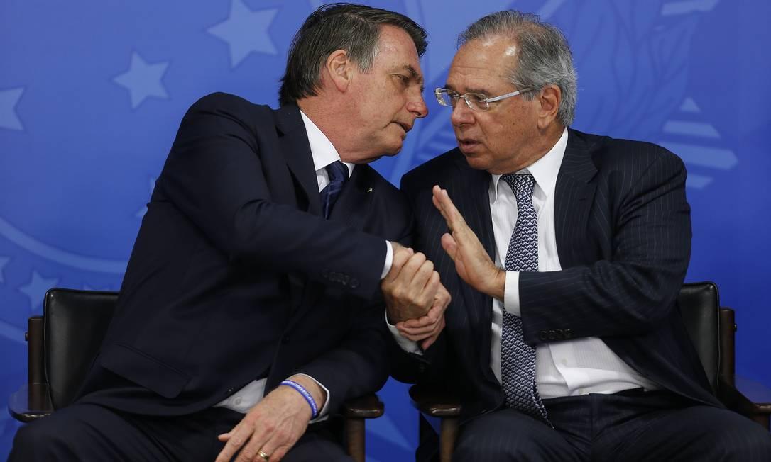 Presidente Jair Bolsonaro e o ministro da Economia, Paulo Guedes Foto: Jorge William / Agência O Globo