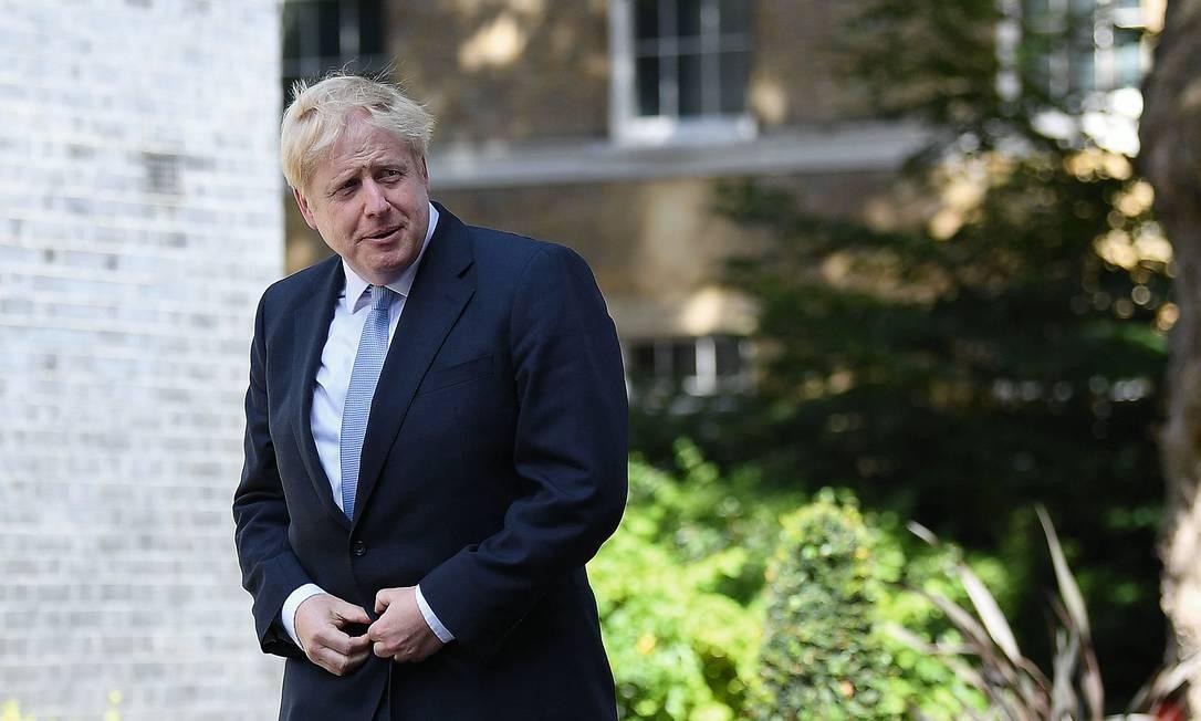 Depois de encontrar na quarta-feira 24 a rainha Elizabeth, que o convidou oficialmente a formar um novo gabinete, Boris Jonhson chega ao número 10 da Rua Downing, em Londres, seu novo endereço. Foto: Ben Stansall / AFP