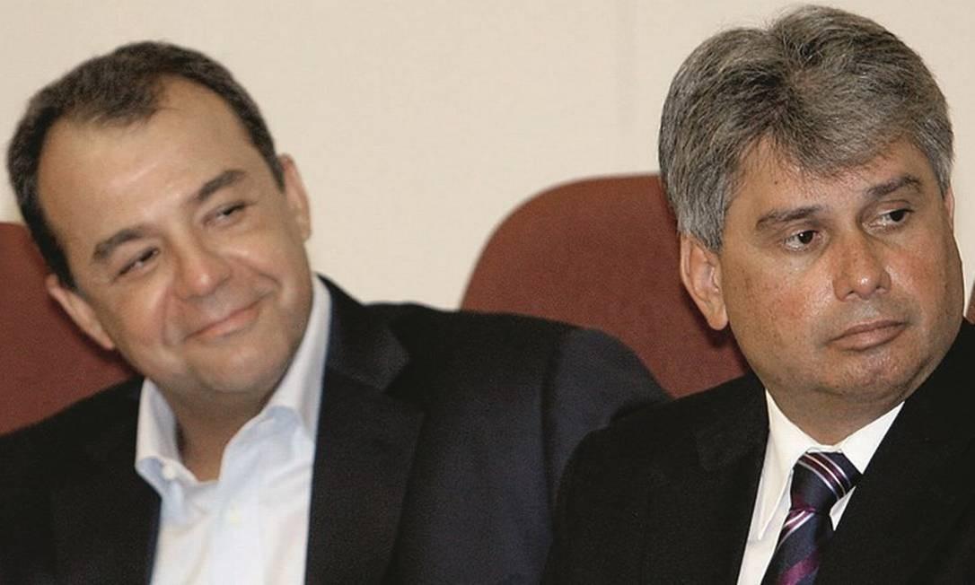 Sérgio Cabral (à esquerda, com o procurador Cláudio Lopes) se beneficiava do esquema das empresas de ônibus. Foto: Marcos Tristão