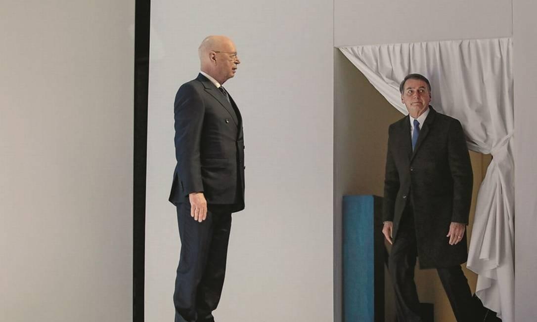 O presidente e criador do fórum, Klaus Schwab (à esquerda), ficou surpreso com a lista de convidados de Bolsonaro. Foto: Jason Alden / Bloomberg / Getty Images