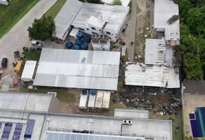 Vista da área sem fiscalização pelos Bombeiros: local da base pegou fogo na sexta-feira Foto: MARIE HOSPITAL / AFP