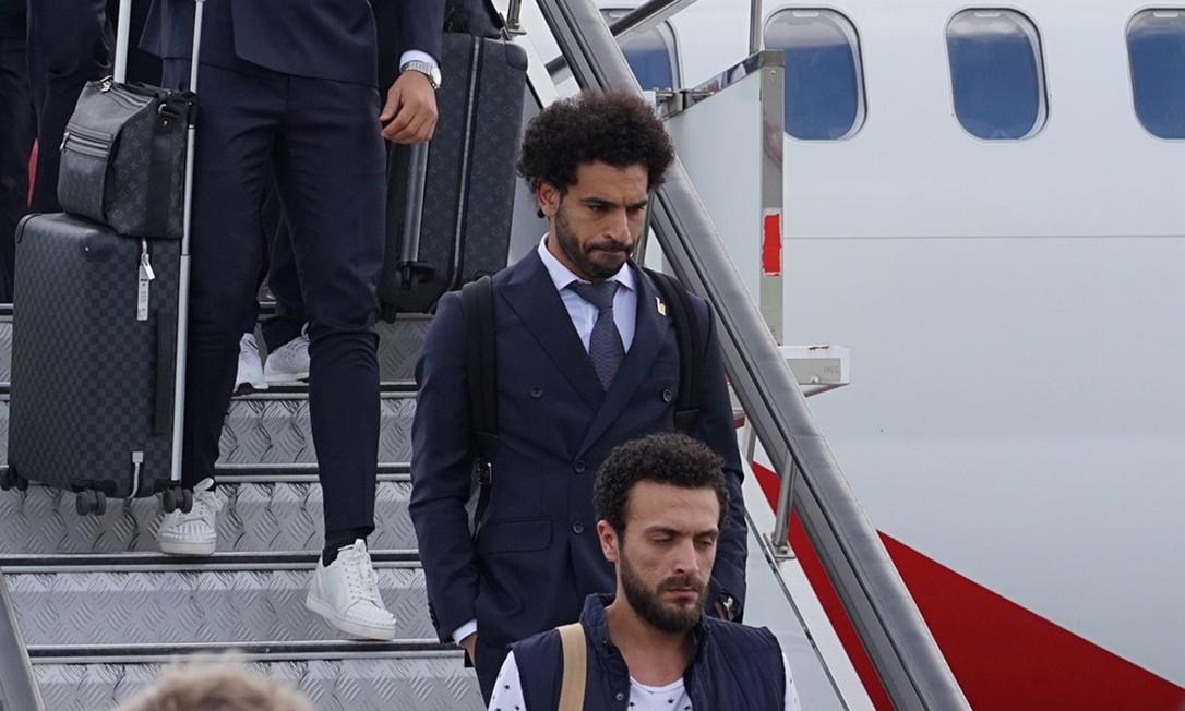 O craque Mohamed Salah não ficou de fora do show de elegância das seleções, com o modelo discreto do Egito. Divulgação/FIFA