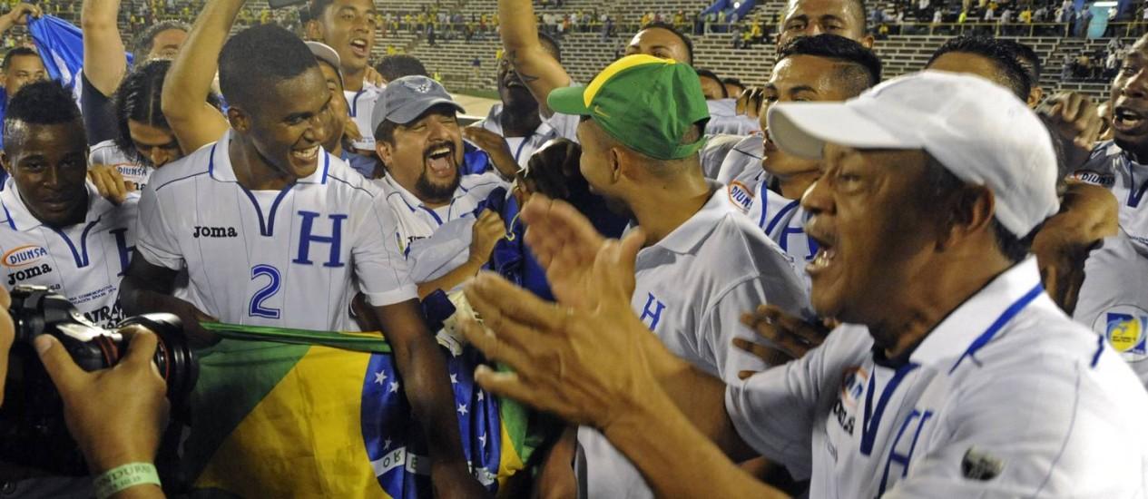 Os jogadores de Honduras comemoram a classificação para a Copa do Mundo de 2014, no Brasil Foto: Collin Reid / AP