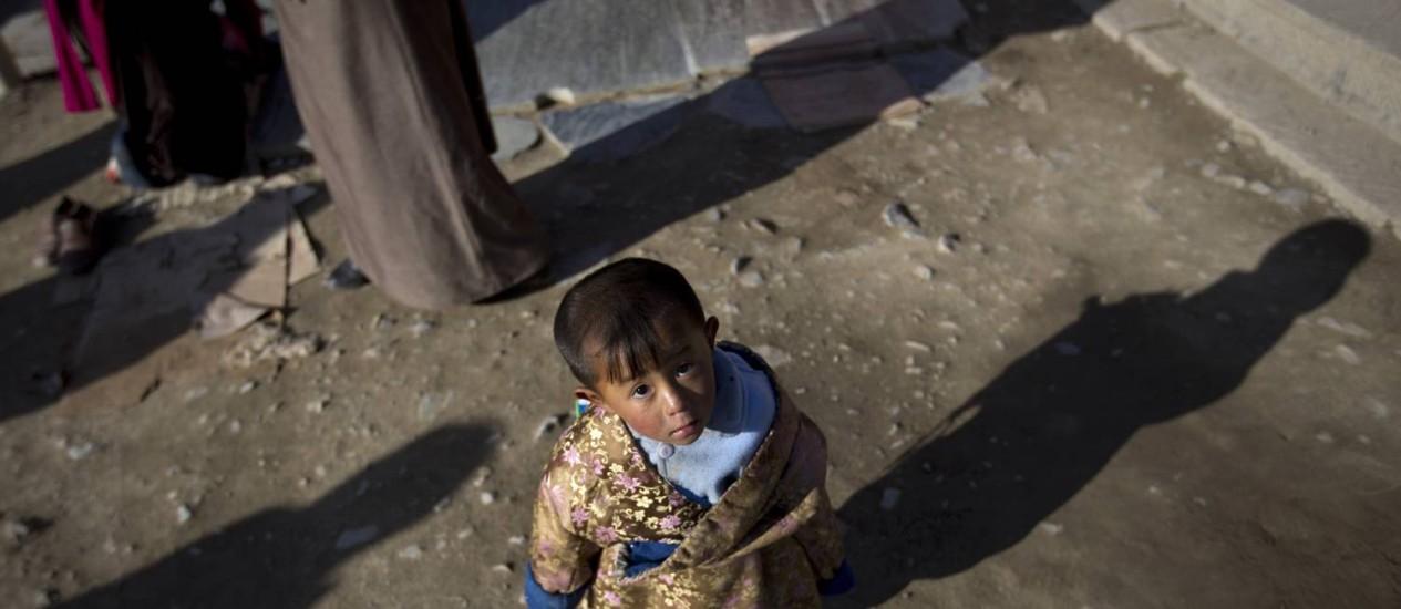 Menino tibetano: crianças sem recursos podem tornarem-se mais deprimidas Foto: Andy Wong/AP