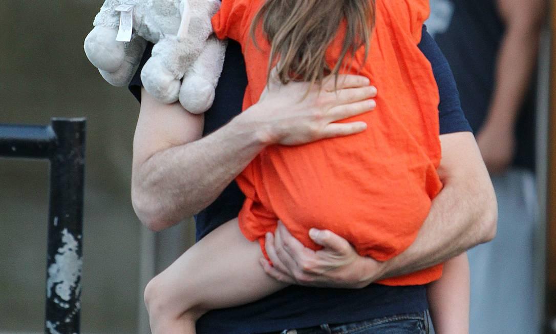 Tom Cruise com a filha Suri em julho de 2012 Donald Traill / AP