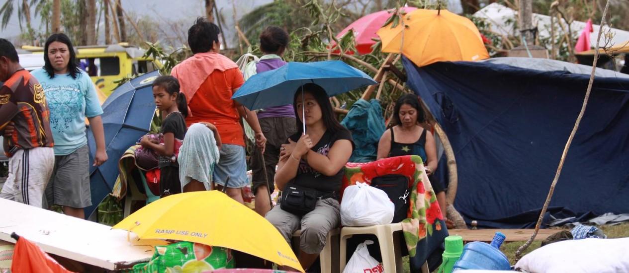 Sobreviventes em Tacloban, nas Filipinas Foto: Praveen Agrawal / AFP