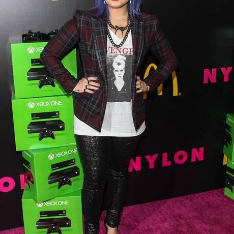 Demi Lovato comparece à festa de lançamento da edição de dezembro da revista Nylon, em Hollywood Foto: Paul A. Hebert/Invision/AP