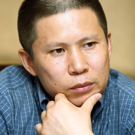 Xu Zhiyong em uma reunião em Pequim, em 2009 Foto: AP-17-7-2009