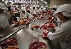Exportação. Empresas que vendem para o exterior têm maior controle Foto: DARIO LOPEZ-MILLS / AP Photo/Dario Lopez-Mills/11-04-2003