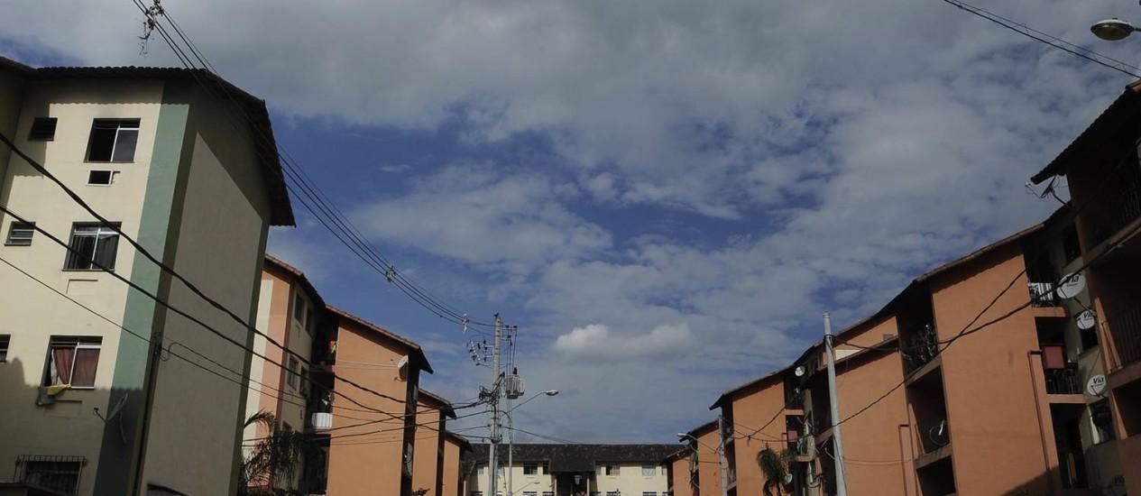 Ameaça. Conjunto do Minha Casa, Minha Vida em Realengo, no Rio: juros do programa ficariam altos para baixa renda Foto: Fabio Teixeira / Fabio Teixeira/28-11-2013