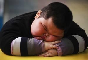 Em 2011, o chinês Lu Zhihao, de 4 anos, tinha 1,1m e pesava 62 kg Foto: JOE TAN / REUTERS
