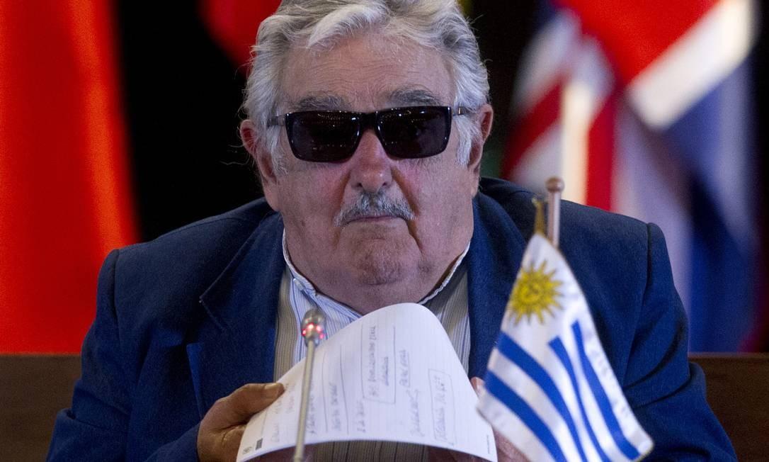 O presidente uruguaio, Jose Mujica, na reunião da Comissão Econômica da América Latina e Caribe: legislação de armas divide Parlamento em Montevidéu Foto: Claudio Reyes / AFP