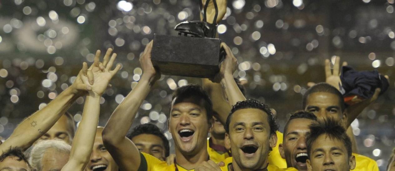 A seleção brasileira comemora o título do Superclássico das Américas de 2011. Jogo deste ano será na China Foto: Juan Mabromata / AFP