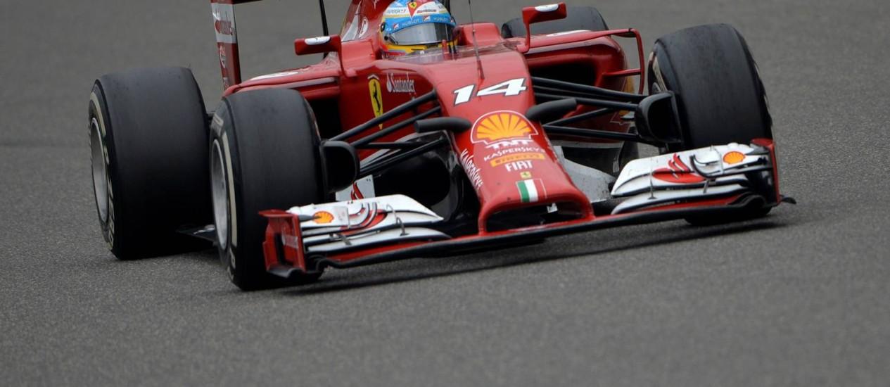 Fernando Alonso em ação no GP da China Foto: MARK RALSTON/AFP