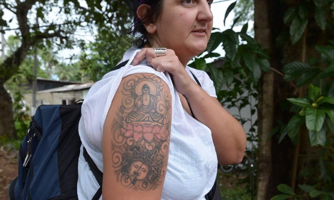 Turista britânica mostra tatuagem de Buda: detida no Sri Lanka Foto: LAKRUWAN WANNIARACHCHI / AFP