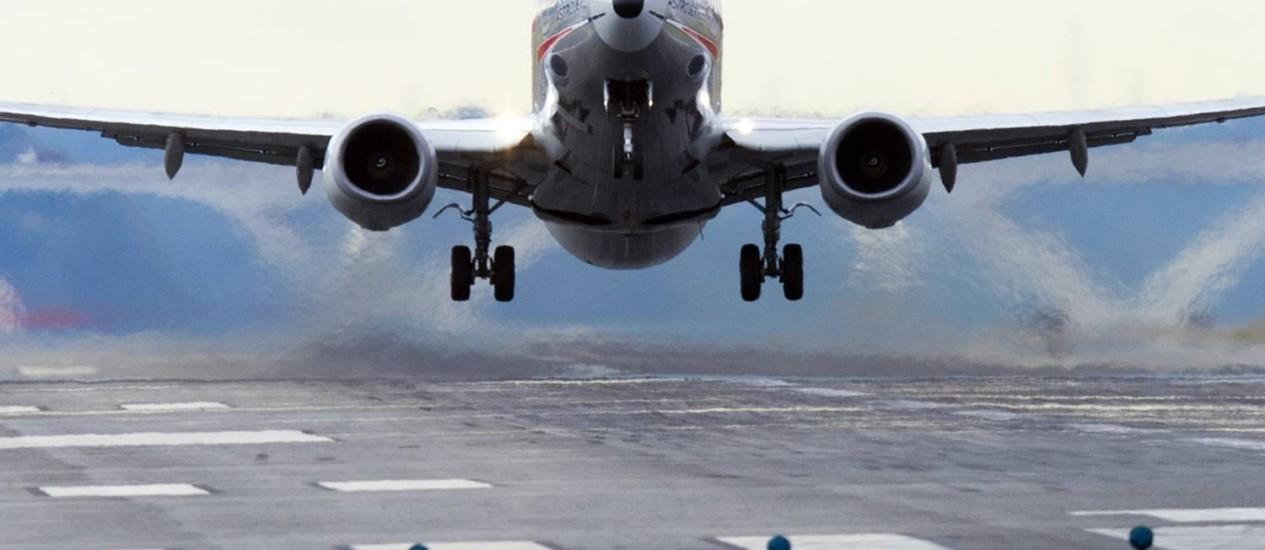 Entregas dos aviões comerciais da Boeing tiveram alavancaram as receitas neste primeiro trimestre de 2014 Foto: SAUL LOEB / AFP