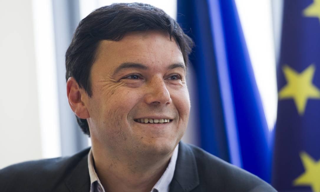 Best-seller. Desde o último dia 22, o livro de Thomas Piketty é o mais vendido na Amazon Foto: / Fred Dufour/AFP/13-3-2013