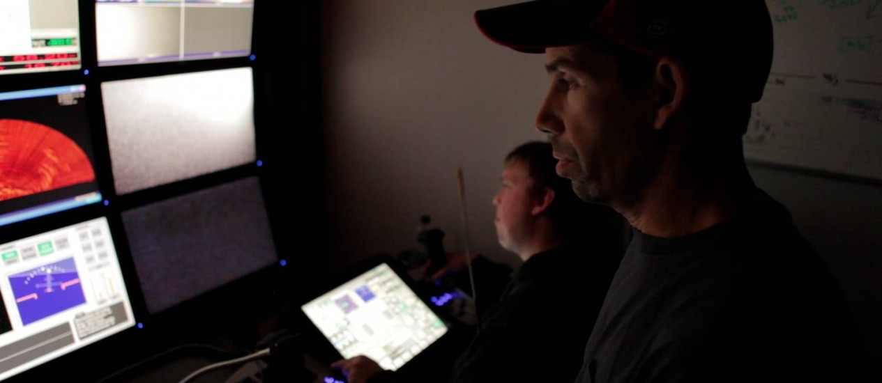 Sala de controle da Odyssey Marine Exploration, especializada em recuperar tesouros no fundo do mar Foto: Divulgaçaõ