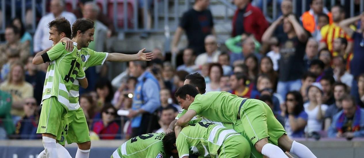 Os jogadores do Getafe comemoram o gol de Lafita aos 48 minutos do segundo tempo Foto: Albert Gea / Reuters