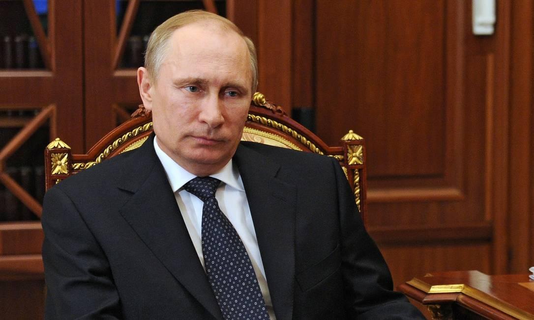 O presidente russo Vladimir Putin em uma reunião em Moscou Foto: MIKHAIL KLIMENTYEV / AFP-6-5-2014