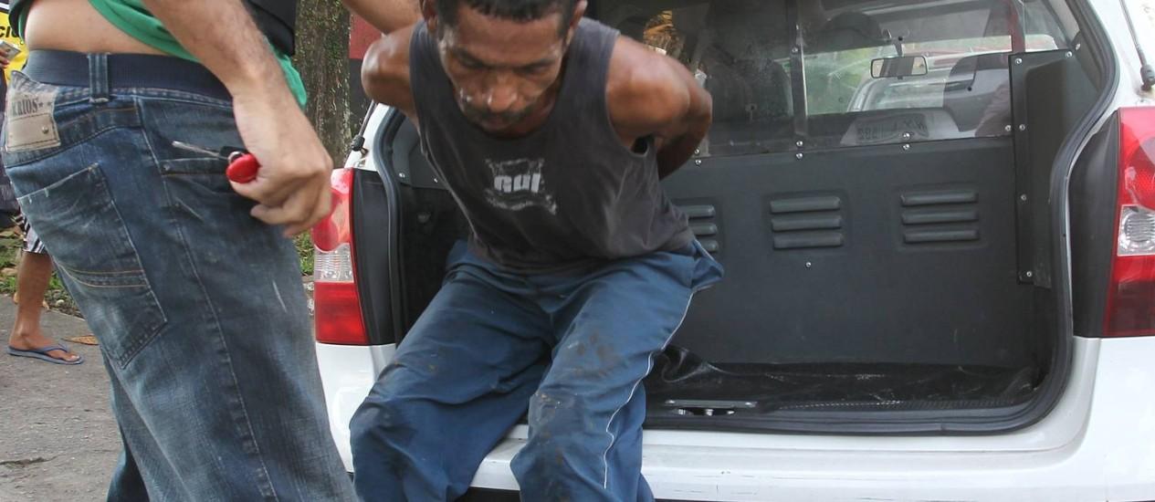 Polícia prendeu um suspeito de participar de linchamento de dona de casa no Guarujá Foto: Marcos Alves / Agência O Globo