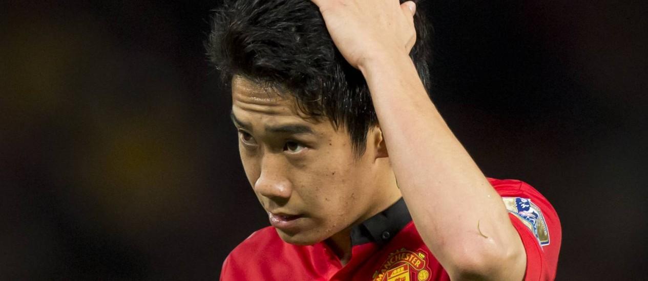 Kagawa foi informado por uma aeromoça que estava na Copa Foto: Jon Super / AP