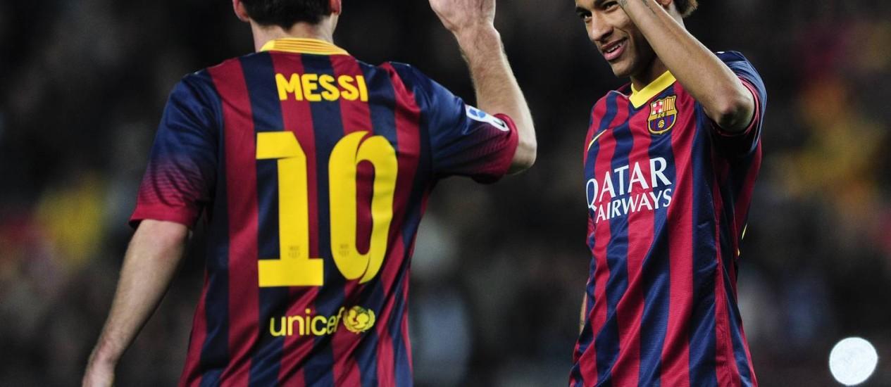 Neymar e Messi, companheiros no Barça e rivais na Copa do Mundo Foto: Josep Lago - AFP