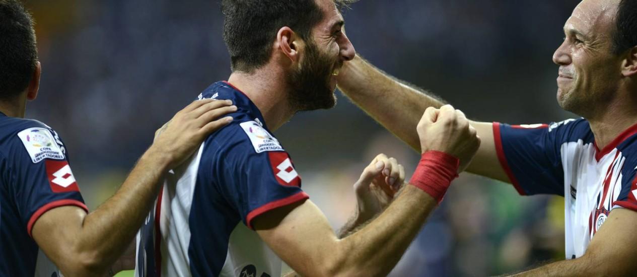 Piatti, do San Lorenzo, comemora o gol que abriu o placar contra o Cruzeiro Foto: Eugenio Savio / AP