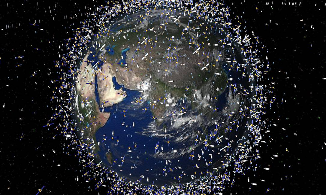 Representação artística do lixo espacial em volta da Terra, de acordo com a Agência Espacial Europeia. Foto: / Foto AFP
