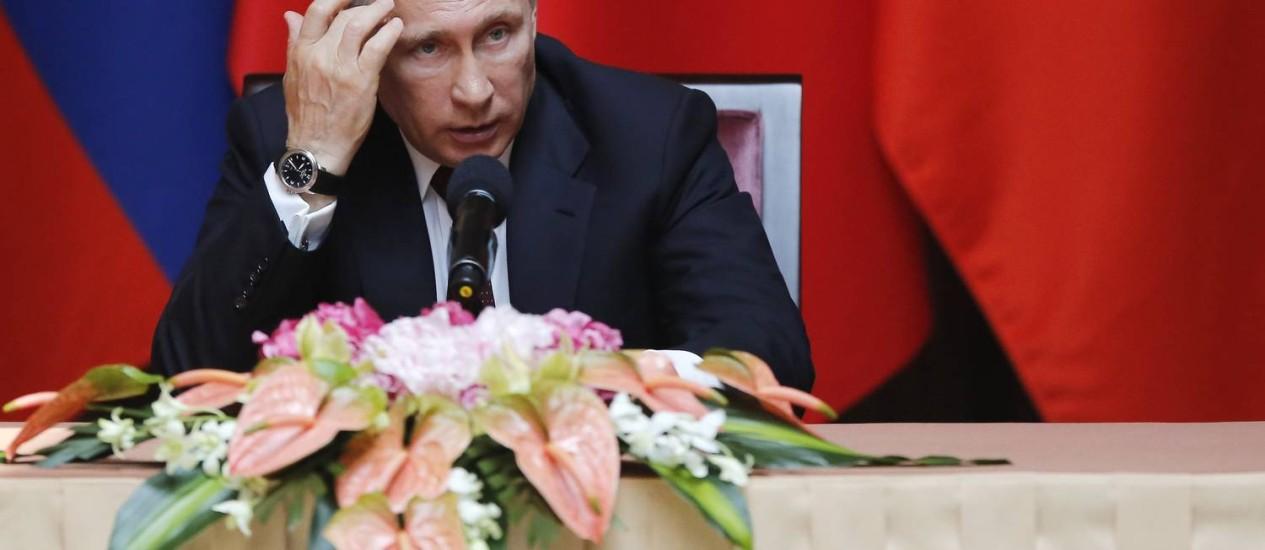Vladimir Putin. Presidente russo tem colecionado comparações com o líder nazista Adolf Hitler após anexação da Crimeia Foto: CARLOS BARRIA / Reuters