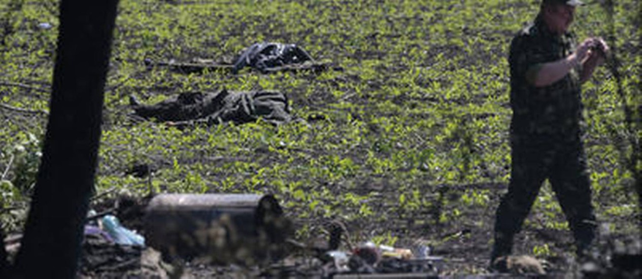 Os corpos de 11 pessoas foram encontrados em um posto de controle militar ucraniano Foto: Ivan Sekretarev/ AP