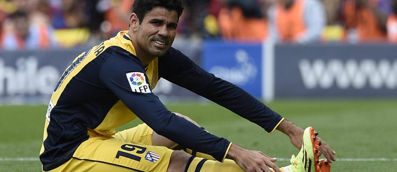 Diego Costa treinou com bola nesta quinta-feira Foto: LLUIS GENE / AFP