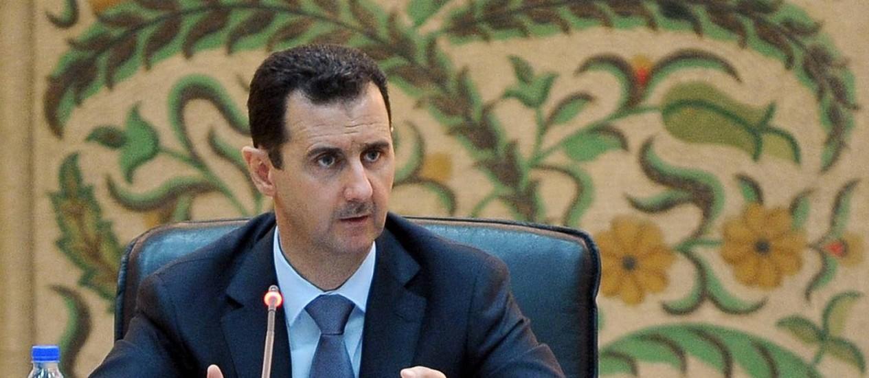 Bashar al-Assad é candidato a reeleição no pleito presidencial que ocorre no país em junho Foto: - / AFP