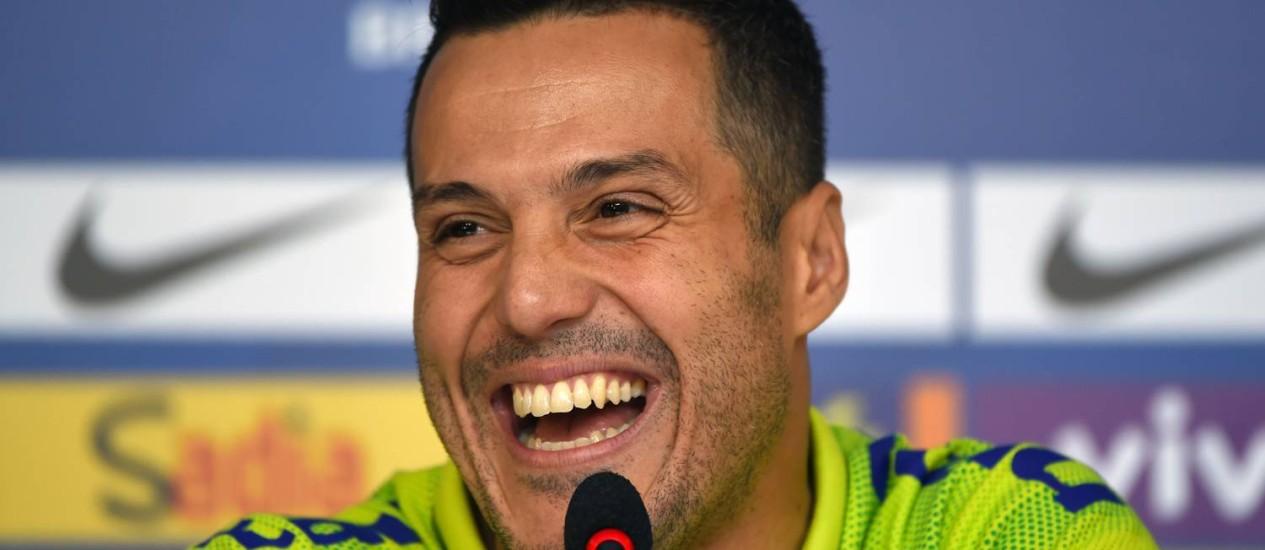 Júlio César sorri durante a coletiva nesta terça-feira Foto: VANDERLEI ALMEIDA / AFP