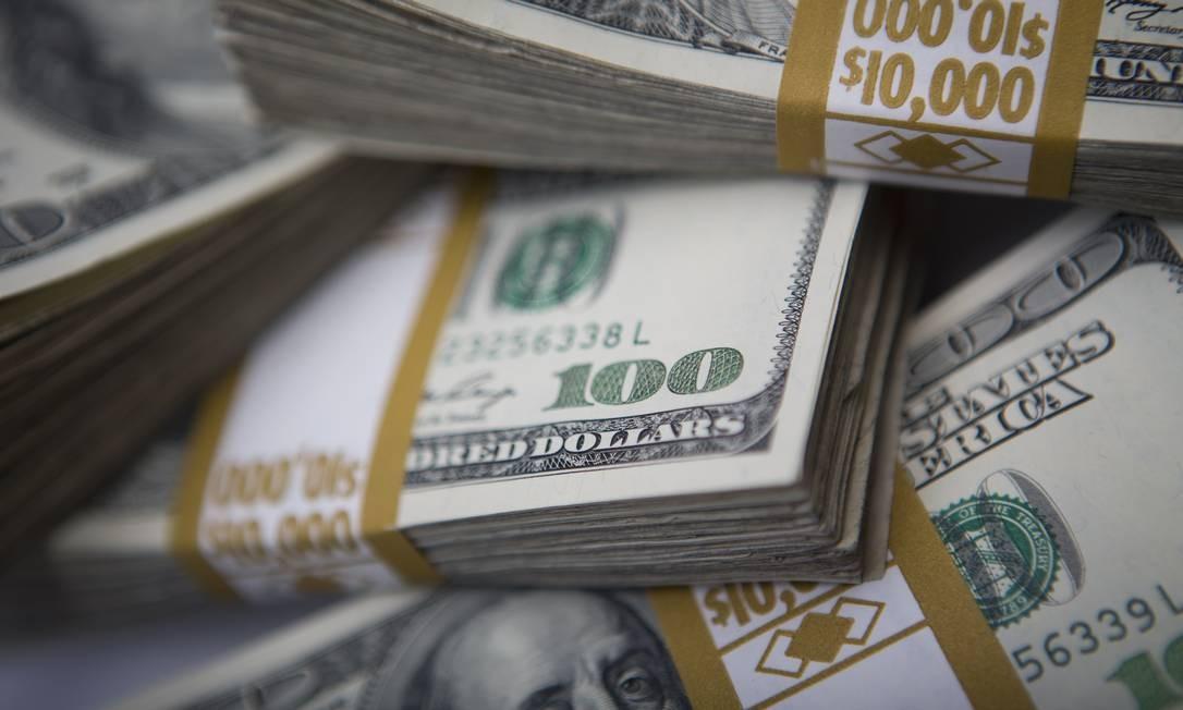 Cédulas de dólar, a moeda oficial dos Estados Unidos Foto: Scott Eells / Bloomberg News