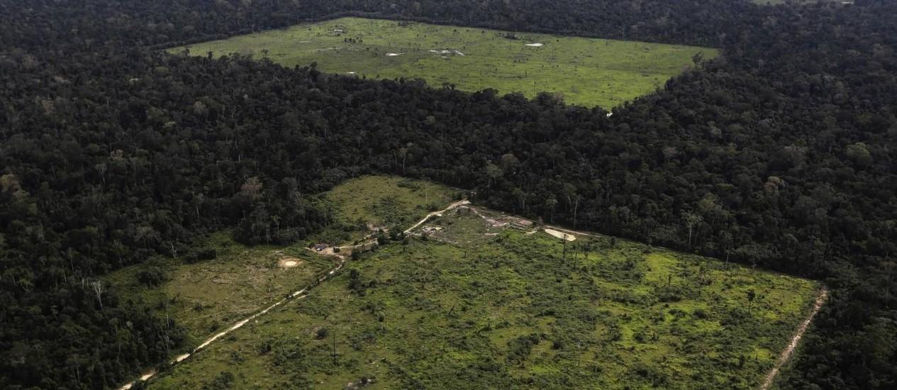 Vista aérea de região desmatada para agricultura na Amazônia: ritmo menor de perda de floresta nos últimos anos colocou Brasil como líder mundial na luta contra o aquecimento global Foto: REUTERS/NACHO DOCE